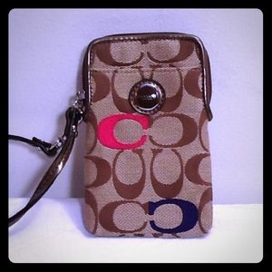 Coach phone case wristlet with 4 card slots inside